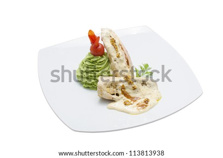 Turkey breast with broccoli in pepper sauce, ready for serving. Isolated on white