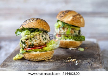 Turkey burgers with guacamole  - stock photo