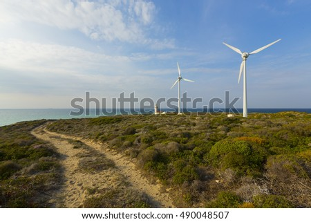 TURKEY - CANAKKALE ; 25 SEPTEMBER 2016 , Windmills on the edge of the cliff near Polente lighthouse at Bozcaada island during sunset
