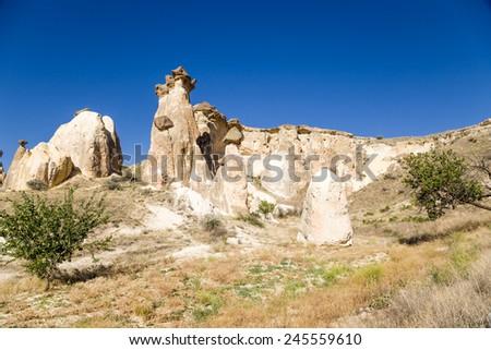 Turkey, Cappadocia. Part of the cave city in the rocks around Cavusin - stock photo