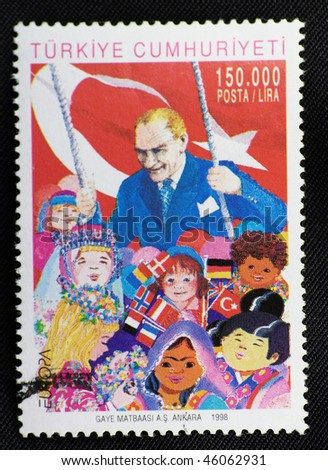 TURKEY - CIRCA 1998: A stamp printed in Turkey shows Mustafa Kemal Ataturk and children, circa 1998