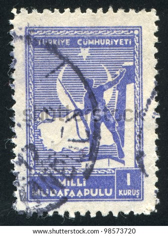 TURKEY- CIRCA 1941: stamp printed by Turkey, shows Soldier and Map of Turkey, circa 1941 - stock photo