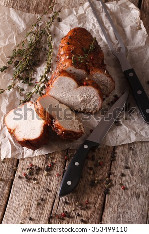 Turkey fillet roasted close-up paper on the table. vertical - stock photo