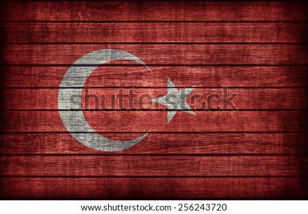 Turkey flag pattern on wooden board texture ,retro vintage style - stock photo