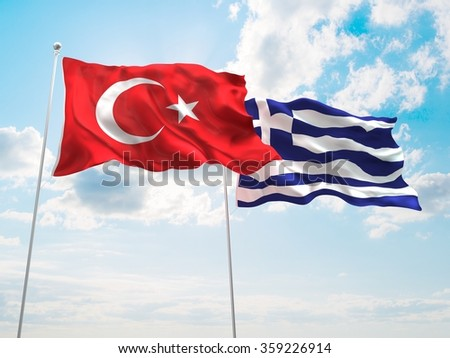 Turkey & Greece Flags are waving in the spring of the blue sky. - stock photo