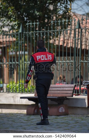 TURKEY, ISTANBUL - APRIL 05, 2016: An Istanbul Policeman talks on the phone