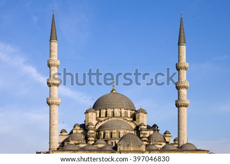 Turkey, Istanbul, New Mosque (Turkish: Yeni Valide Cami) domes and minarets, Ottoman imperial mosque.