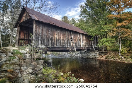 Turkey Jim's covered bridge in New Hampshire. On August 28, 2011, a powerful tropical storm Irene caused many rivers to flood and sweeping away this bridge. It was destroyed and no longer exists now. - stock photo