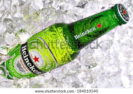 TURKEY - MARCH 26, 2014 Bottle of Heineken Lager Beer on crushed ice background. Heineken is a brand of lager beer brewed in Holland.