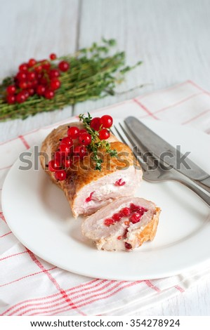 Turkey or chicken breast stuffed with red currant berries, selective focus