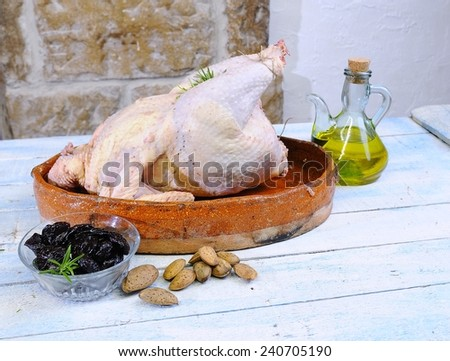Turkey prepared on the wooden table in the kitchen.  - stock photo