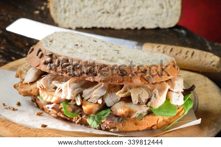 Turkey sandwich freshly made from Thanksgiving, Christmas turkey leftovers on wholemeal bread.