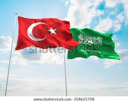 Turkey & Saudi Arabia Flags are waving in the spring of the blue sky. - stock photo