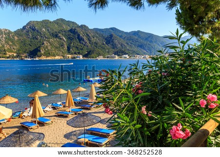 turkey seashore, white sand seacoast, a ship in the water, summer vacation in europe - stock photo