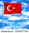 Turkey waving flag against blue sky - stock photo