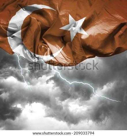 Turkey waving flag on a bad day - stock photo