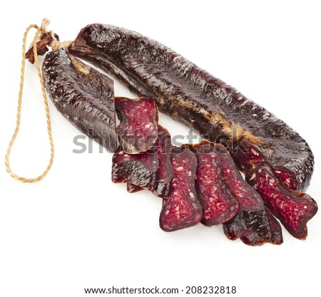 Turkic solid sausages sudzhuk isolated on white background - stock photo