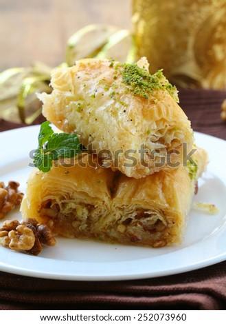 Turkish arabic dessert - baklava with honey and walnut nuts - stock photo