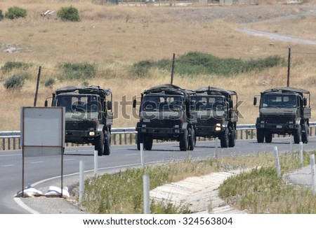 Turkish army vehicles are keep going border of Turkey-Syria, 6 July 2015, Kilis.Turkey. - stock photo