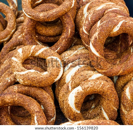 Turkish bagel, also known as simit. It is a circular bread with sesame seeds. - stock photo