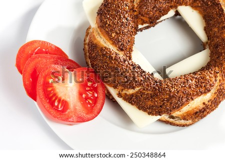Turkish bagel (simit) with cheese on plate - stock photo