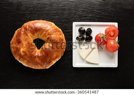 Turkish bagel / tomato / cheese / olive - simit
