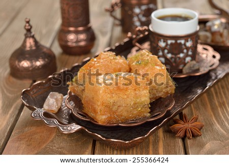 Turkish baklava on a brown background - stock photo