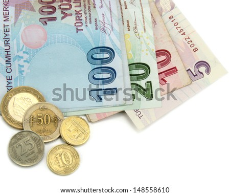 Turkish banknotes and coins on white background. - stock photo