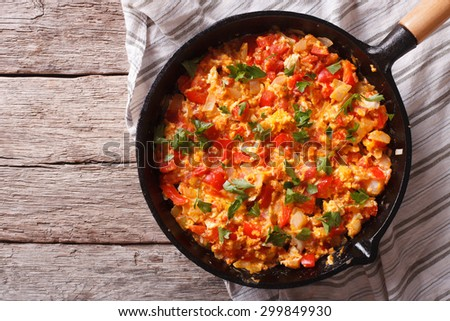 Turkish breakfast: omelet with vegetables in a pan close-up. top view horizontal - stock photo
