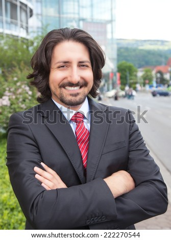 Turkish businessman with suit in front of his office