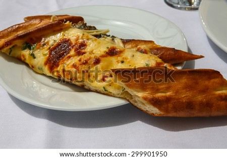 Turkish cheese pastry with fresh herbs and spices