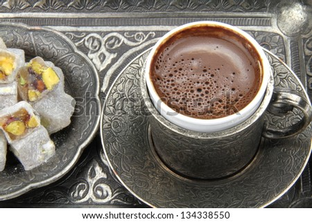 Turkish coffee and turkish delight with traditional embossed metal tray and cup - stock photo