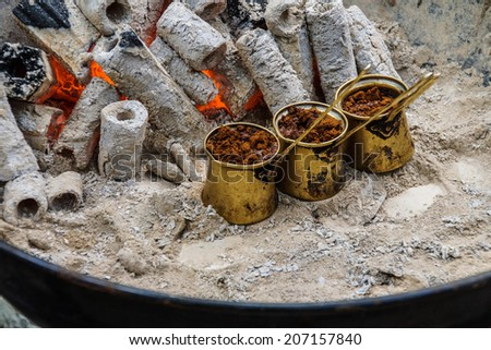 Turkish coffee brewed on charcoal in traditional method,  Safranbolu, Turkey - stock photo