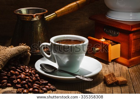 Turkish coffee on cup  and a few blank piece of chocolate and coffeepot
