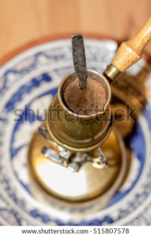 Turkish coffee pot boiling.