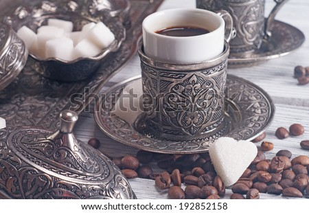 Turkish coffee with traditional embossed metal tray and cup - stock photo