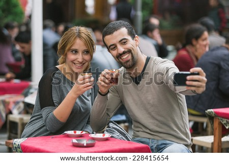 Turkish Couple Taking Selfie while Drinking Cay, Traditional Tea