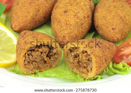 Turkish cuisine, bulgur coated meatballs  - ( icli kofte ) - stock photo