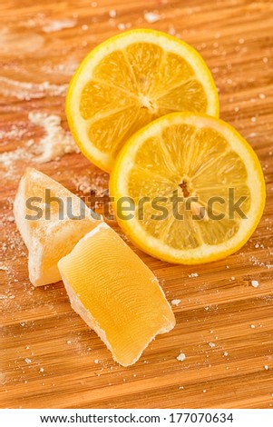 Turkish delight and lemon isolated on wooden background - stock photo