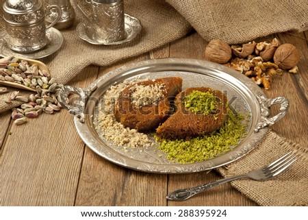 Turkish dessert kadayif kunefe with pistachios and walnuts - stock photo