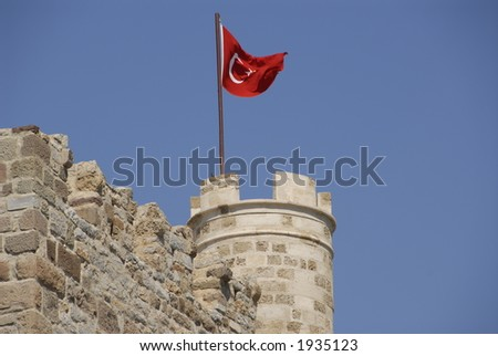 Turkish Flag on Medieval Castle - stock photo