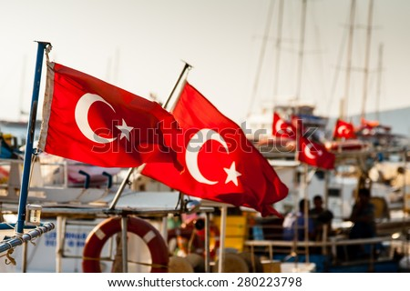 Turkish flags on boats moored at Bodrum, Turkey. - stock photo