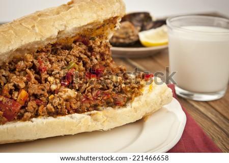 Turkish Kokorec - lamb intestine food sandwich with midye dolma and ayran - stock photo