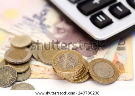 Turkish lira bills, coins and calculator close up, shallow DOF - stock photo
