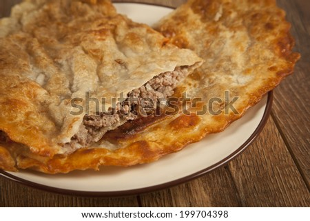Turkish meat pie fried in oil ( Cig borek ) ( Raw pie or Tatar pie )