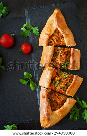 Turkish pide traditional food with beef and vegetables. Top view - stock photo