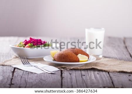 Turkish Ramadan Food icli kofte ( meatball ) falafel on wooden table - stock photo