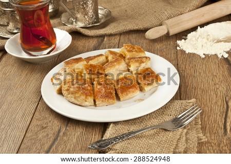 Turkish style meat stuffed filo dough borek served kol boregi - stock photo