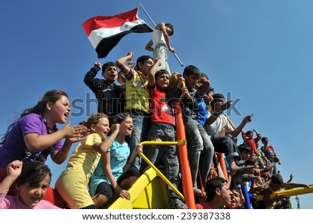 TURKISH-SYRIAN BORDER -JUNE 18, 2011: unidentified Syrian people are demonstrating against Beshar Al Assad on June 18, 2011 on the Turkish - Syrian border. - stock photo