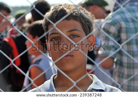 TURKISH-SYRIAN BORDER -JUNE 18, 2011: unidentified Syrian people in refugee camp in Turkey on June 18, 2011 on the Turkish - Syrian border. - stock photo